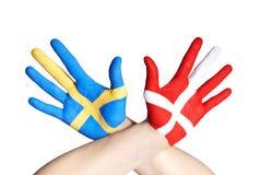 Danish and swedish hands Royalty Free Stock Photo