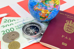 Danish Travel World. A still life of Danish travel objects, cash, kroner, passport, compass, map, and coins Royalty Free Stock Image