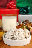 Danish Wedding Cookies and Chrristmas Gifts. A bowl of Danish Wedding Cookies with eggnog, fruitcake and Christmas gifts Royalty Free Stock Photography