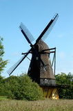 Danish Windmill. Old Danish windmill behind a cornfield and blue sky Royalty Free Stock Images