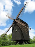 Danish wooden windmill. Old Danish wooden windmill under blue sky with clouds Stock Photos