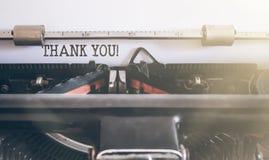 DANK U geschreven op uitstekende handschrijfmachine Stock Fotografie