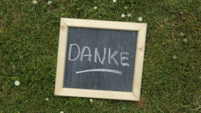Danke écrit photographie stock