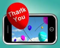 Danke im Ballon aufsteigt Mitteilung als Dank, der auf Mobile gesendet wird Stockfotos
