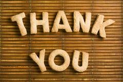 Danke Wörter mit selbst gemachten Keks-Buchstaben Lizenzfreie Stockfotografie