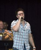Danny Gokey, American Idol, Performing. American Idol Danny Gokey singing on stage in Milwaukee, Wisconsin. The venue location was the Summerfest grounds next to stock photo