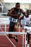 Danny McFarlane em obstáculos de 400 medidores Fotografia de Stock Royalty Free