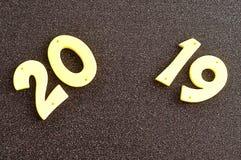 2019 dans des nombres jaunes Photos stock