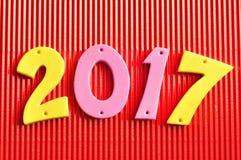 2017 dans des nombres roses et jaunes Photographie stock libre de droits