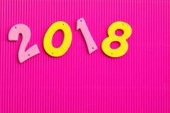 2018 dans des nombres roses et jaunes Photo libre de droits