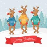 Dans för tre hjortar ovanför skogliggande skjuten snowtreesvinter glad vykort för jul Arkivbild