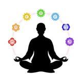 Dans la méditation avec des chakras Photographie stock