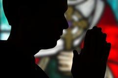 Dans la prière Photo stock