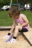 Dans le bac à sable Photographie stock libre de droits