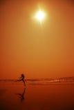 Dans in oranje nacht Stock Fotografie