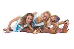 Dansa laget i sjömanlikformign som poserar mot isolerad vit bakgrund Royaltyfri Fotografi