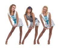 Dansa laget i sjömanlikformign som poserar mot isolerad vit bakgrund Arkivbild