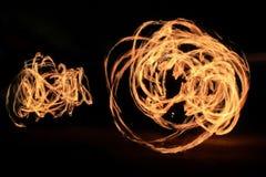 Dansa ljusa slingor Fotografering för Bildbyråer