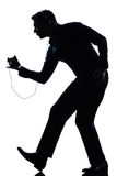 Danse d'homme de silhouette écoutant la musique Image libre de droits