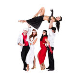 Équipe de danseur de cabaret habillée dans des costumes de cru Photographie stock
