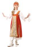 Danse de jeune fille dans la robe nationale Images libres de droits