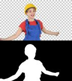 Danse femelle de travailleur de la construction heureuse, Alpha Channel images stock