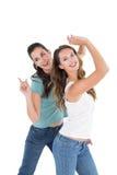 Danse femelle gaie de deux jeune amis Photo stock
