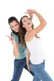 Danse femelle gaie de deux jeune amis Photographie stock