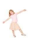 Danse heureuse de petite fille. D'isolement sur le blanc photographie stock libre de droits