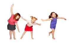 Danse heureuse de petits enfants. Réception joyeuse. Images stock