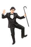 Danse masculine de comédien avec une canne photos stock