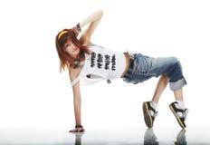 Danse mignonne de jeune femme photo stock