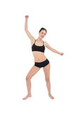 Danse sportive de jeune femme d'isolement sur le fond blanc Photographie stock