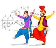 Dansend Punjabi-paar Stock Afbeeldingen