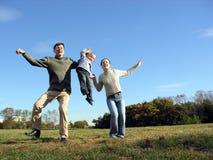 Dansende familie: -) Stock Foto