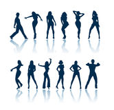 Dansende mensensilhouetten Royalty-vrije Stock Foto's