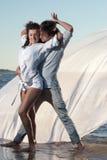 Dansers op het strand Stock Fotografie