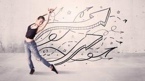Danseur de rue avec des flèches et des étoiles photographie stock libre de droits