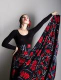 Danseur espagnol de flamenco de fille sur un fond gris Photos libres de droits