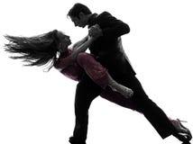 Danseurs de salle de bal de femme d'homme de couples tangoing la silhouette Images stock