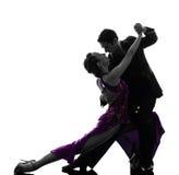 Danseurs de salle de bal de femme d'homme de couples tangoing la silhouette Photo stock