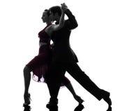 Danseurs de salle de bal de femme d'homme de couples tangoing la silhouette photographie stock