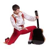 Dansman som bär en toreadordräkt med gitarren Royaltyfri Bild