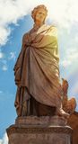 Dante. Sculpture of dante alighieri in florence with sunlight Stock Images