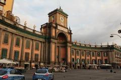 Dante square Naples. Bright orange colored historical ( Convitto Nazionale Vittoria Emanuele) building with book market in the main square Royalty Free Stock Photo