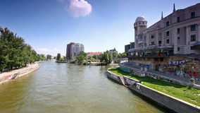 Danube Canal in Vienna at the historic building Urania stock footage