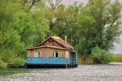 Danube River. Landscape in Danube Delta. Floating traditional house - landmark attraction in Romania Royalty Free Stock Photo