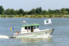 Danube Delta Biosphere Reserve Authority boat on Danube river. Danube Delta Biosphere Reserve Authority boat taking part on a demonstrative exercise during royalty free stock photo
