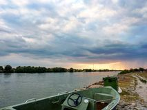 Danube Delta. Boat parked on side of Danube Delta river royalty free stock photos