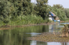 Danube delta - RAW format. Cottage on a channel in Danube delta royalty free stock photo